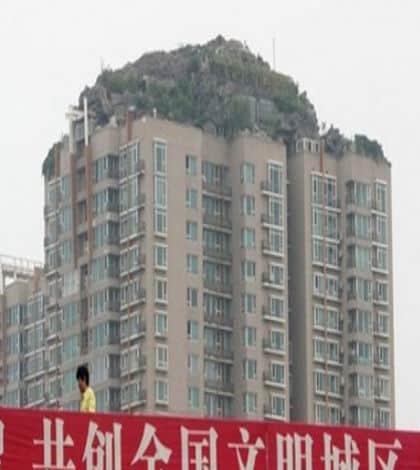 Man builds landscape on building roof