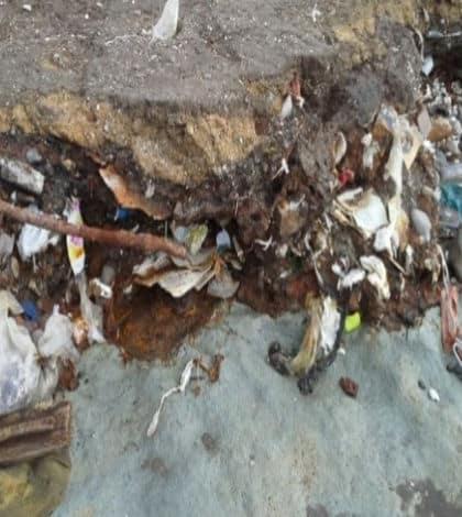 Coastal erosion shows old dump