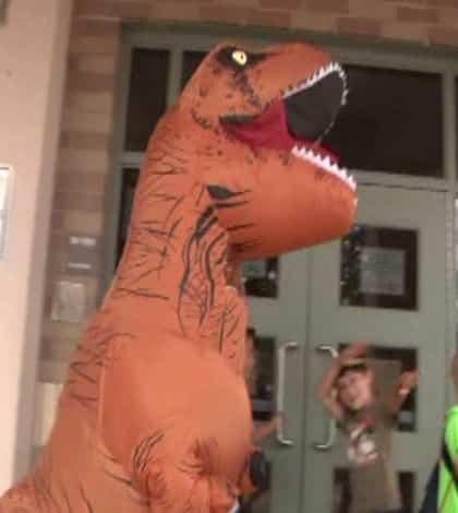 Mum wears dinosaur outfit to school